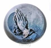 Presse papier biddende handen toewijding