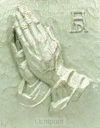 Wandbord biddende handen groot bronsgroe