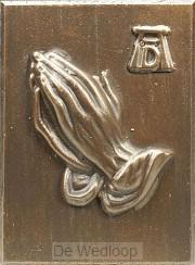 Wandbord biddende handen klein brons